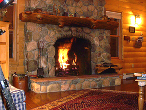 The builder hand-picked the Arkansas River stones for this cozy fireplace.